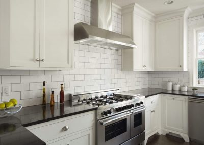 Modern-Kitchen-With-White-Subway-Tile-478427147-56a49fe65f9b58b7d0d7e2d4
