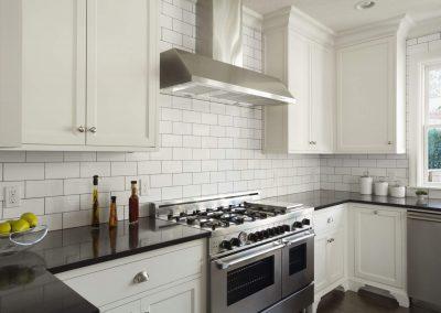Modern-Kitchen-With-White-Subway-Tile-478427147-56a49fe65f9b58b7d0d7e2d4